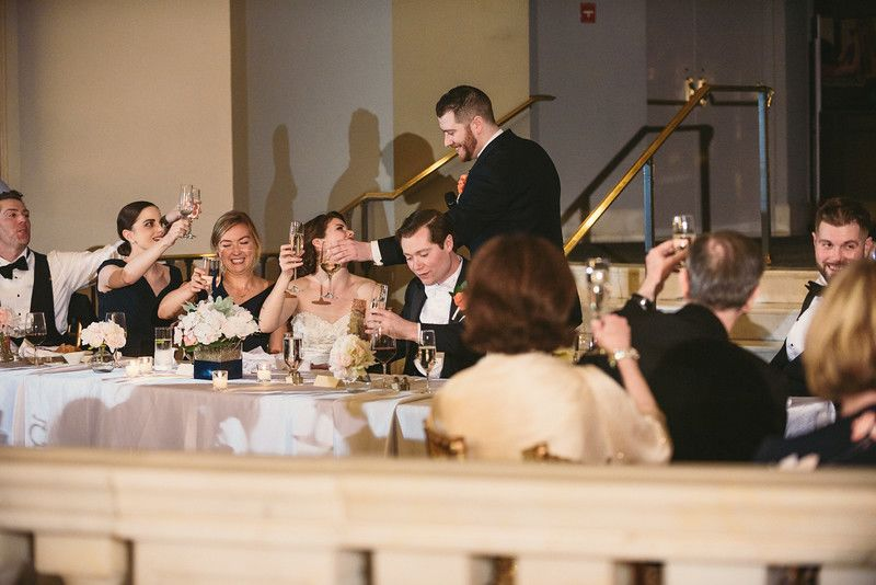 Toasts and Cheers during a wedding reception at NMWA in DC
