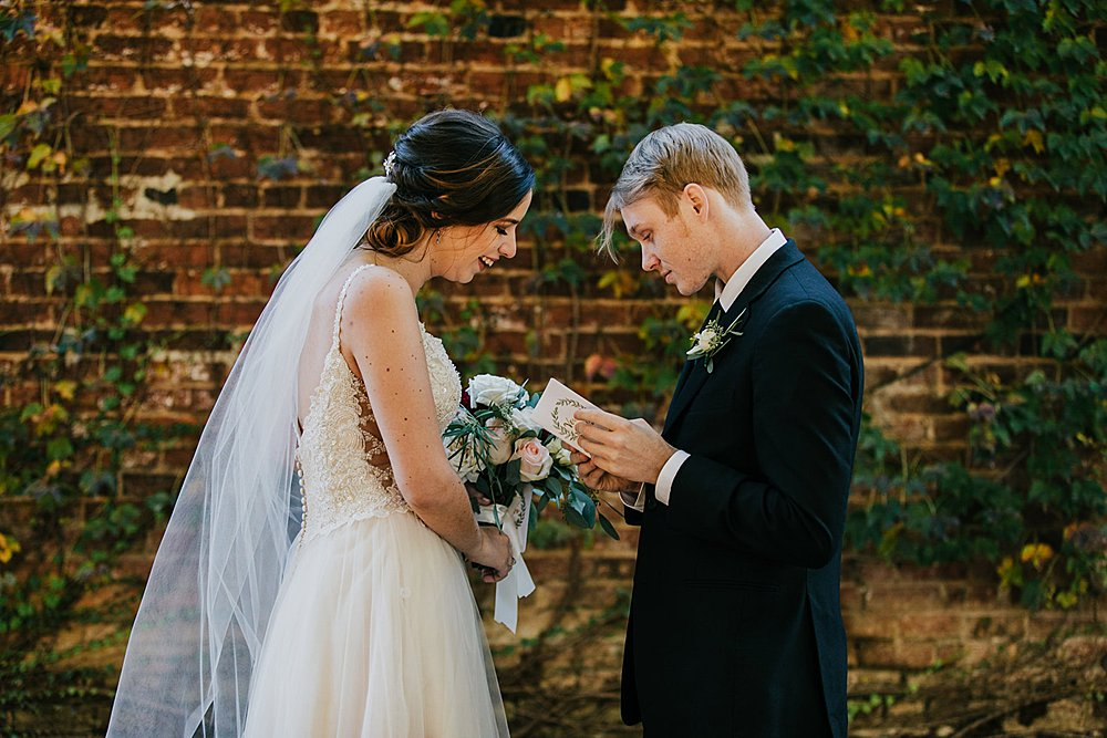 couple exchanging private vows during the first look