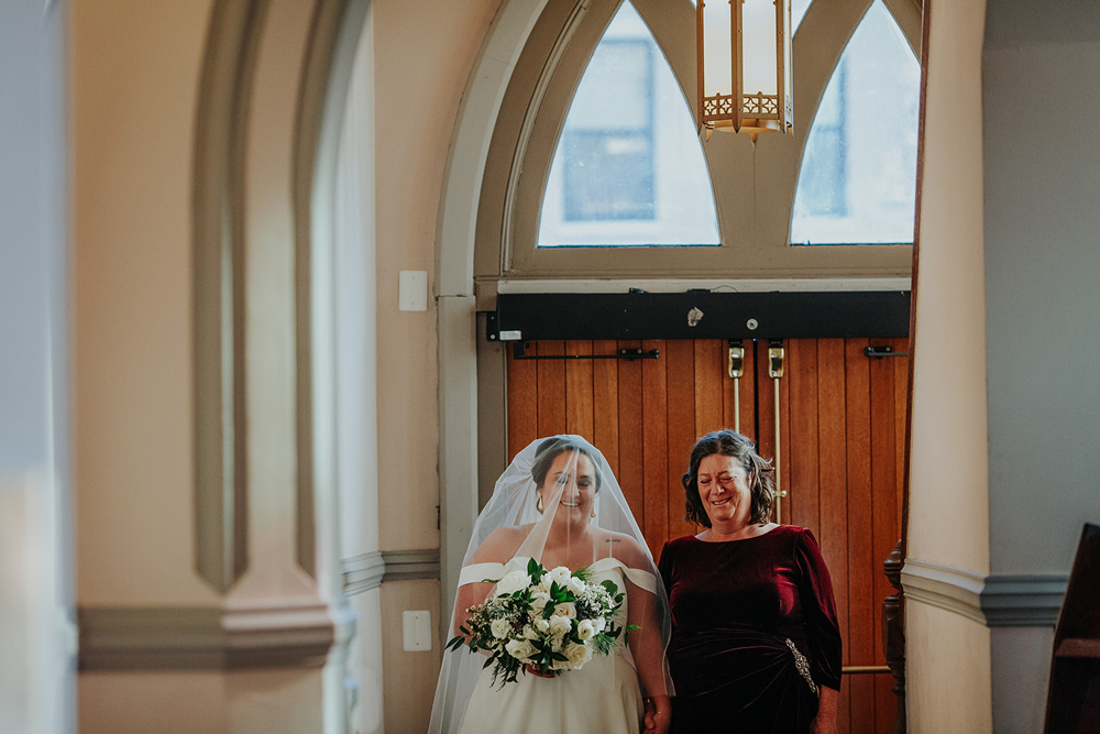this bride's mother walked her down the aisle, as they honor her father's memory
