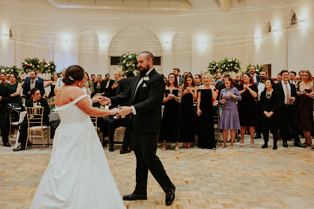 The couple's first dance to Frank Sinatra for their magical winter wedding