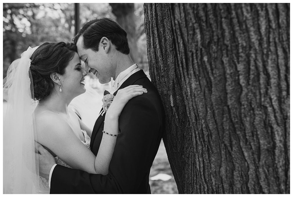 A moment between newlyweds on their Memorial Day weekend wedding