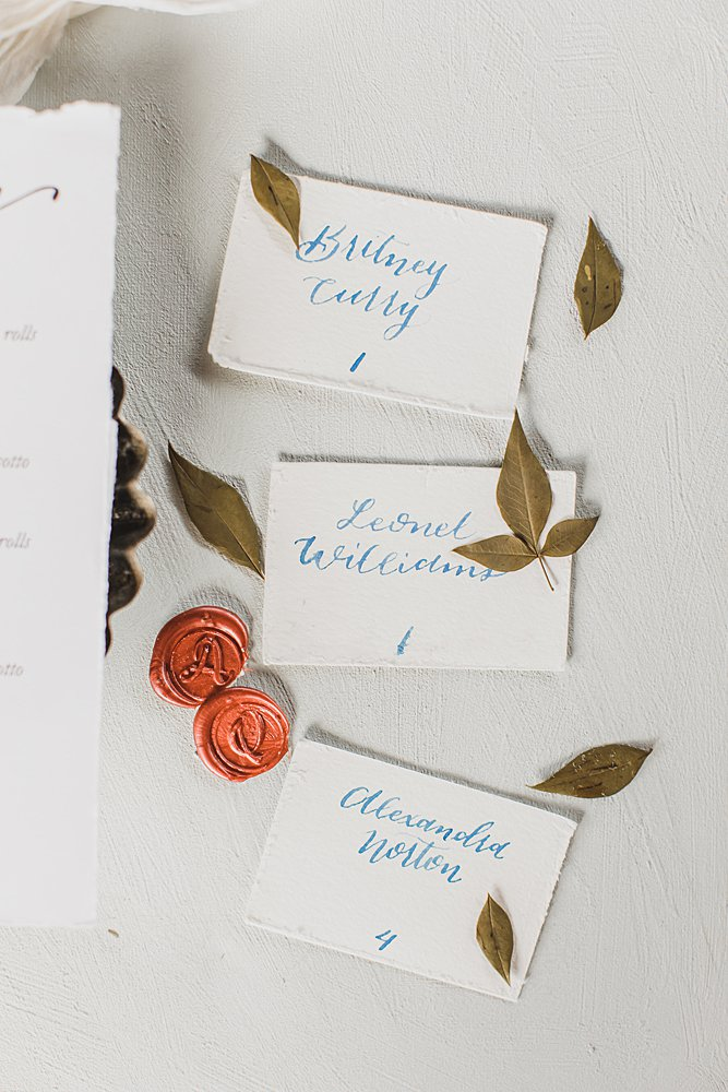 escort cards greenery and wax seals for a summer wedding