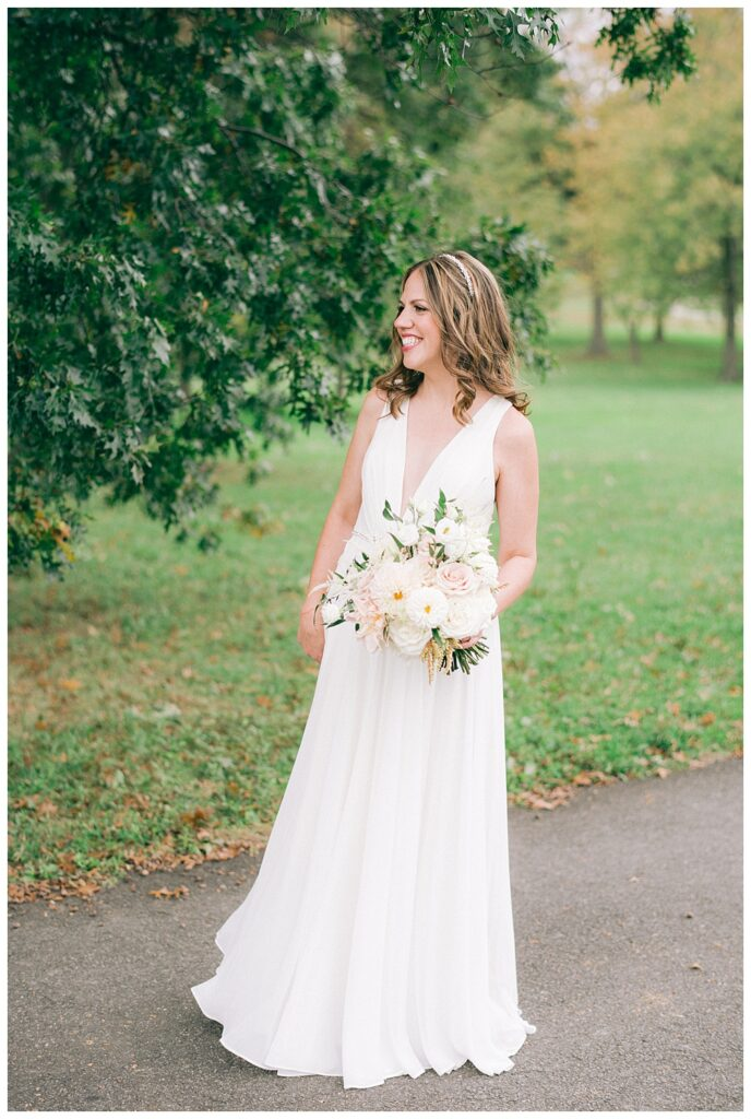 first look photos outside Top of the Town for a fall 2020 wedding